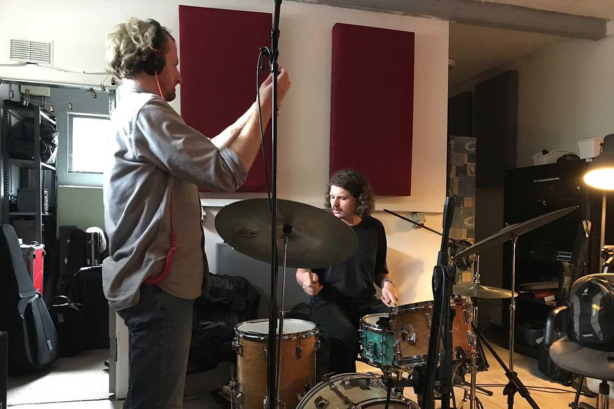 Engineer and Drummer in Studio