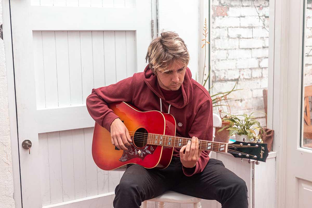 Finn Playing Guitar