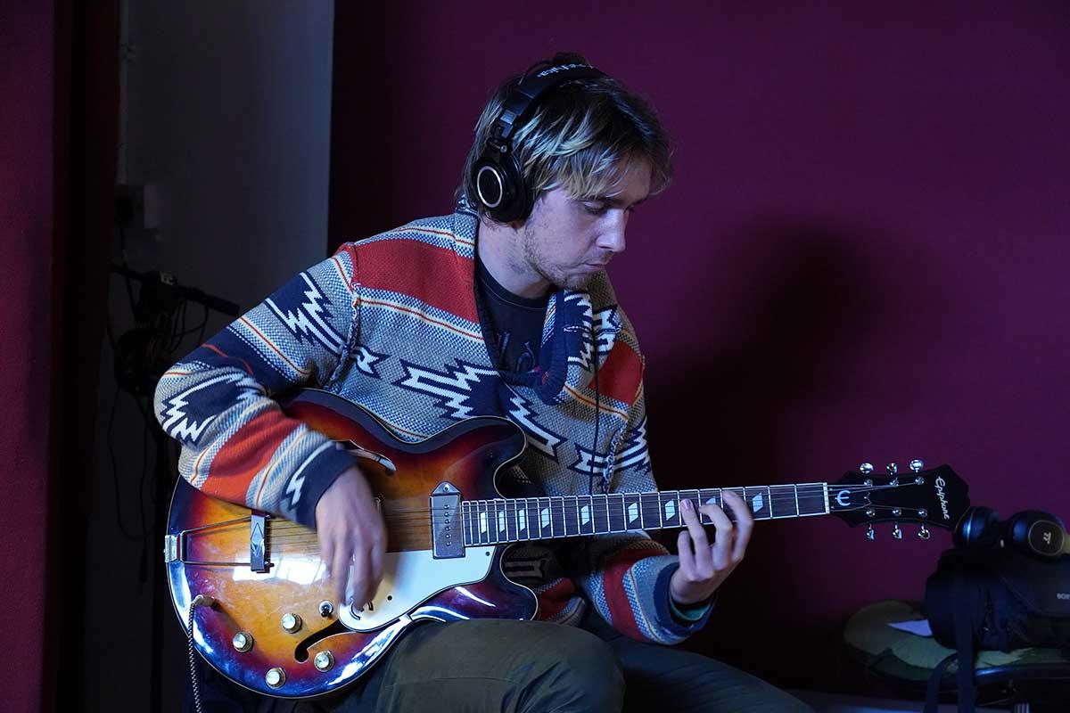 Purple Finn With Guitar